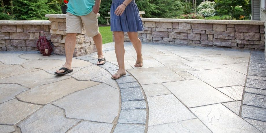 Products shown: Grand flagstone, New Mission paver, Dimensional flagstone, Belvedere wall, Dimensional coping and 27″ column cap.